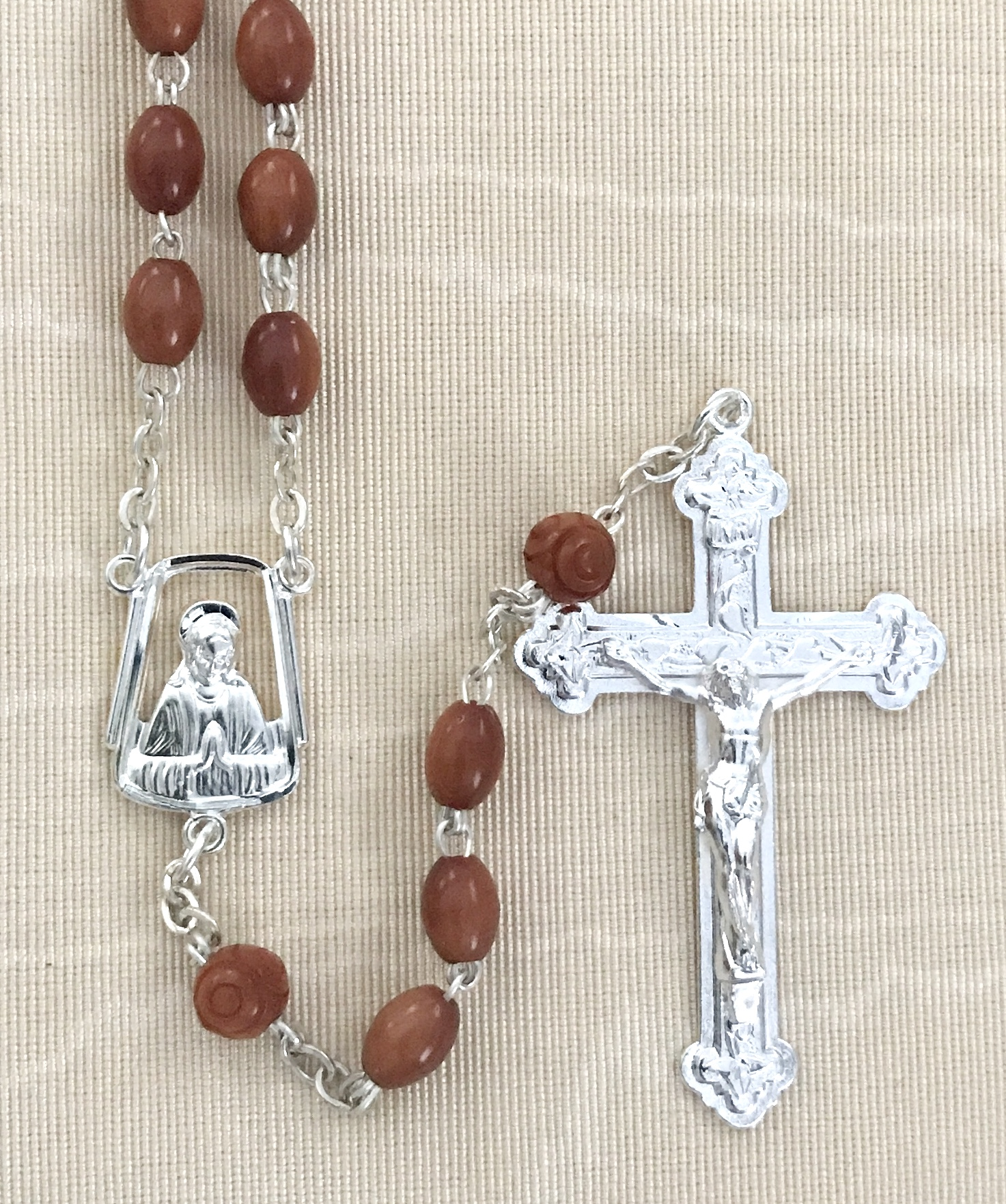 BROWN OVAL COCO ROSARY WITH STERLING SILVER PLATED CRUCIFIX AND CENTER GIFT BOXED