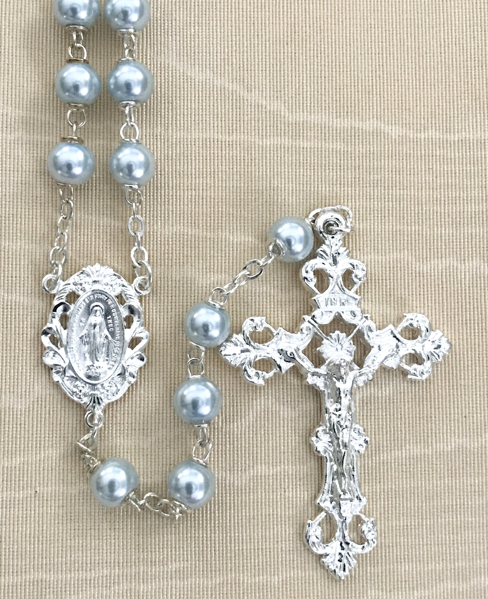 7mm ROUND LIGHT BLUE PEARL ROSARY WITH STERLING SILVER PLATED CRUCIFIX AND CENTER GIFT BOXED
