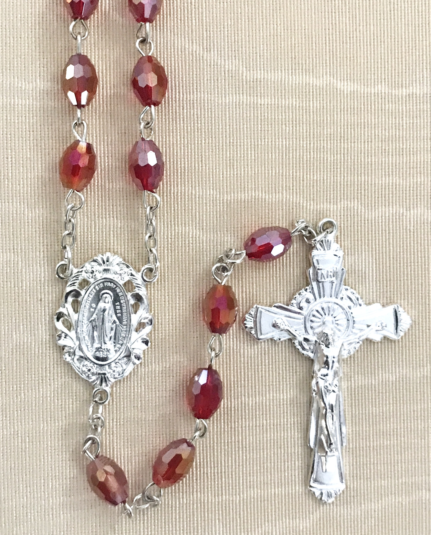 7x5mm TIN CUT RUBY ROSARY WITH STERLING SILVER PLATED CRUCIFIX AND CENTER GIFT BOXED