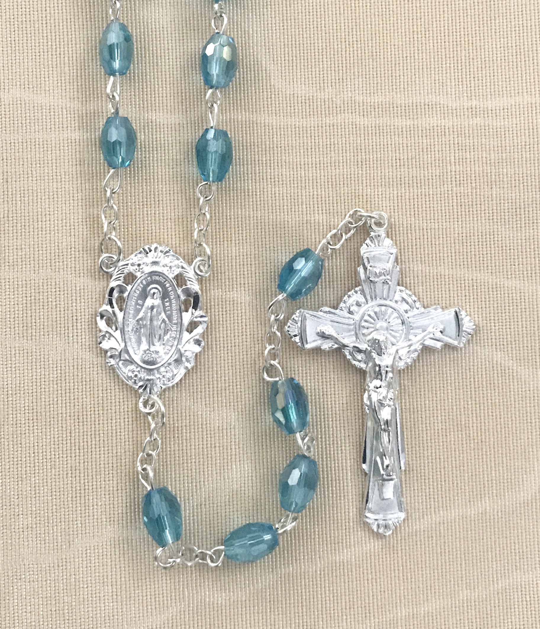7x5mm TIN CUT AQUA ROSARY WITH STERLING SILVER PLATED CRUCIFIX AND CENTER GIFT BOXED