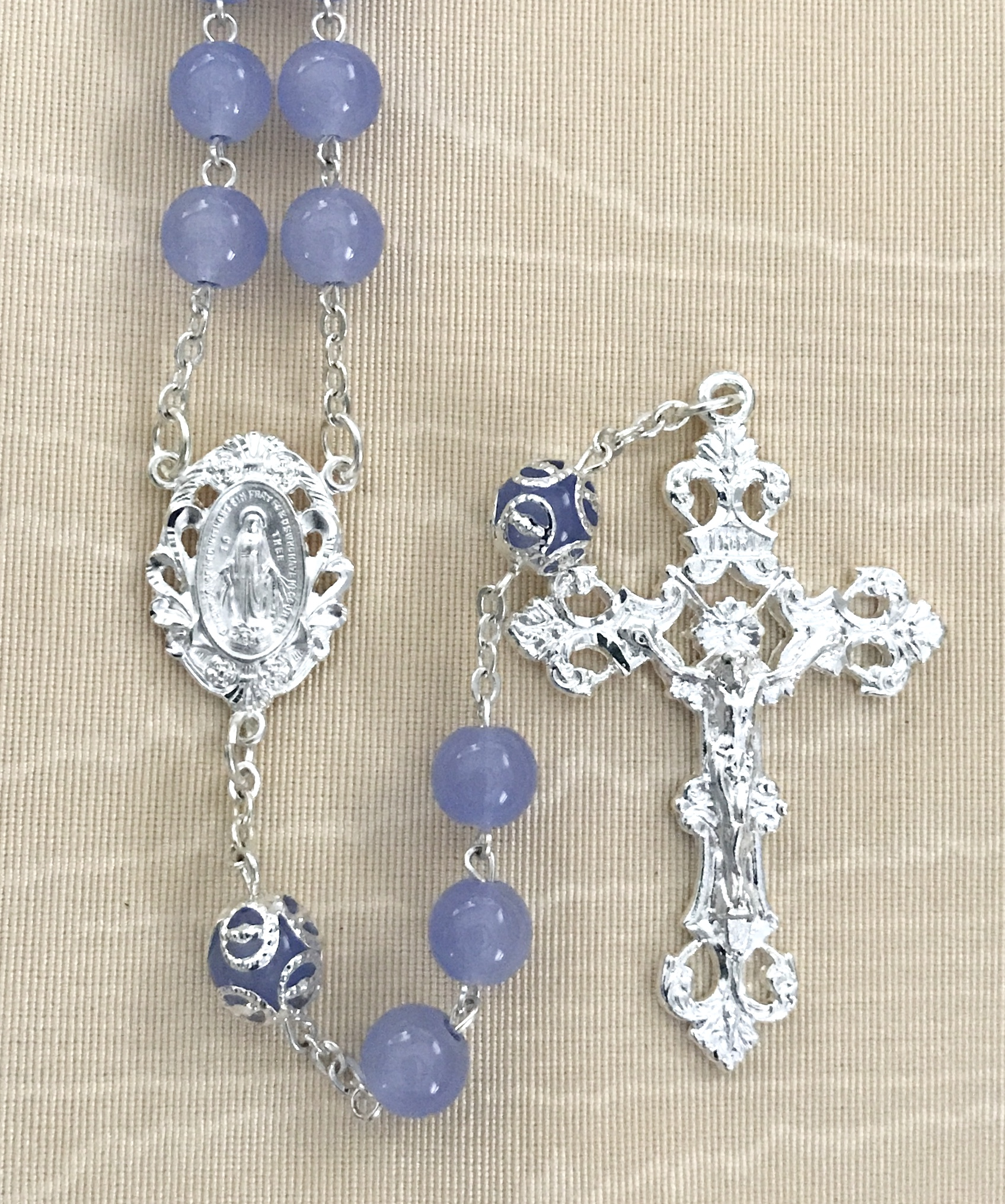8mm LIGHT SAPPHIRE ROSARY  WITH CAPPED OUR FATHER BEADS AND STERLING SILVER PLATED CRUCIFIX AND CENTER GIFT BOXED