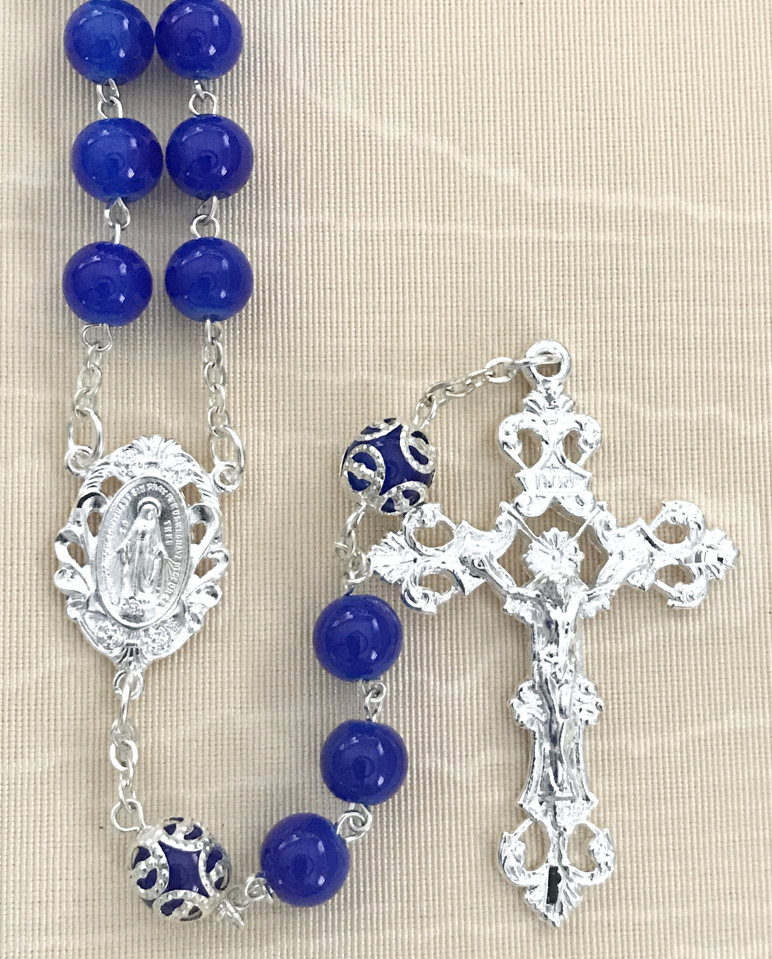 8mm DARK SAPPHIRE GLASS ROSARY WITH CAPPED OUR FATHER BEADS AND STERLING SILVER PLATED CRUCIFIX AND CENTER GIFT BOXED