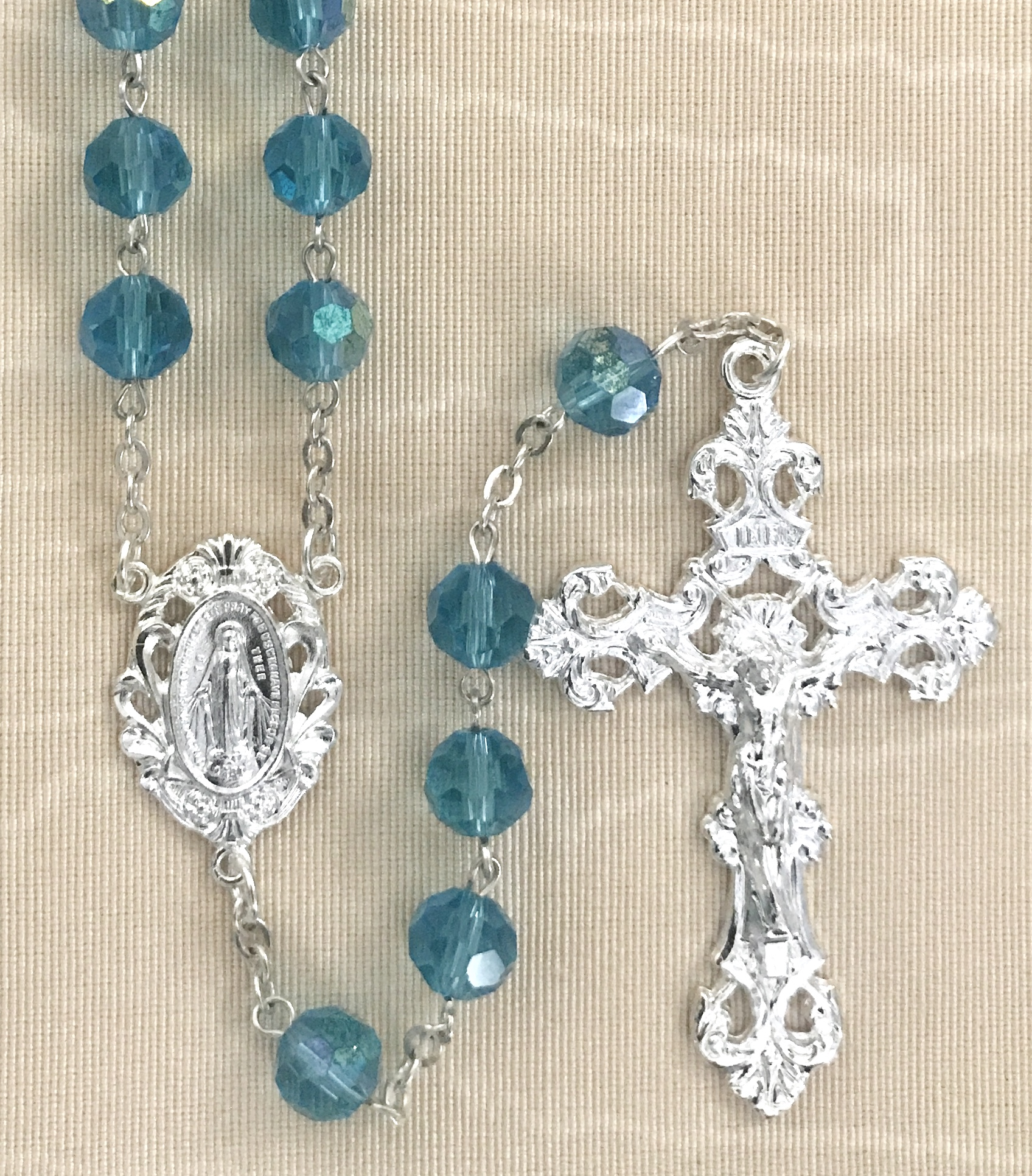 8mm AQUA TIN CUT ROSARY WITH STERLING SILVER PLATED CRUCIFIX AND CENTER GIFT BOXED