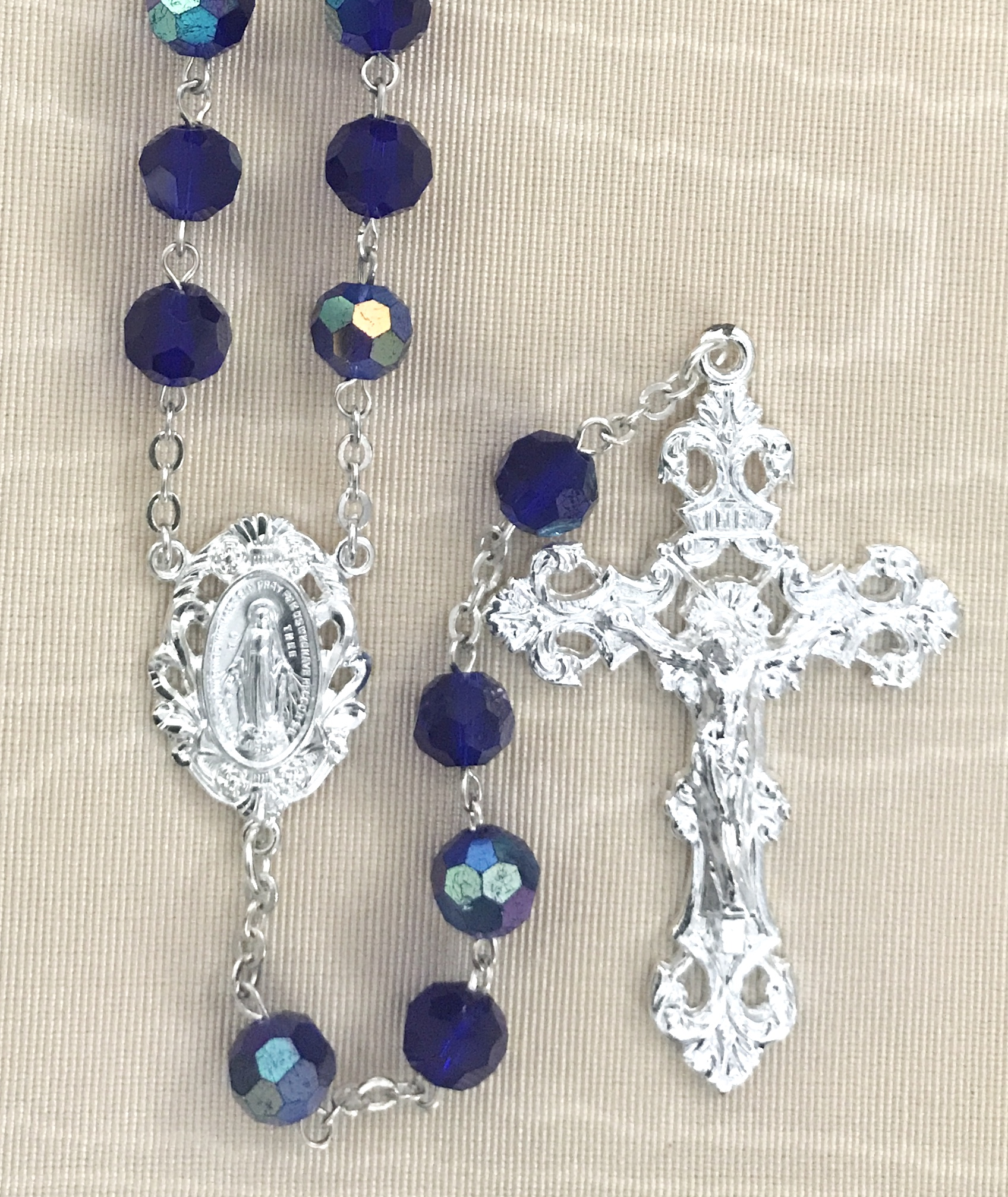 8mm DARK SAPPHIRE TIN CUT ROSARY WITH STERLING SILVER PLATED CRUCIFIX AND CENTER GIFT BOXED